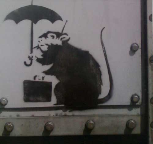 Banksy draws a rat: Rat with briefcase.