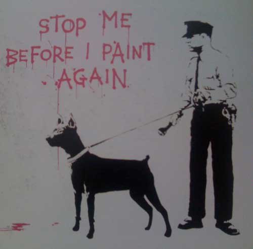 Banksy grafitti of a cop and dog.