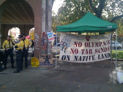 A sign reads: no olympics on stolen land.