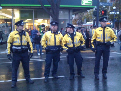 Police line up at the Olympics trying to help make the streets safer, but contribute to a menacing feel.