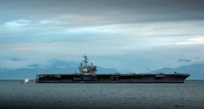 USS Ronald Reagan sitting in Esquimalt Harbour, by Darcy Merrick