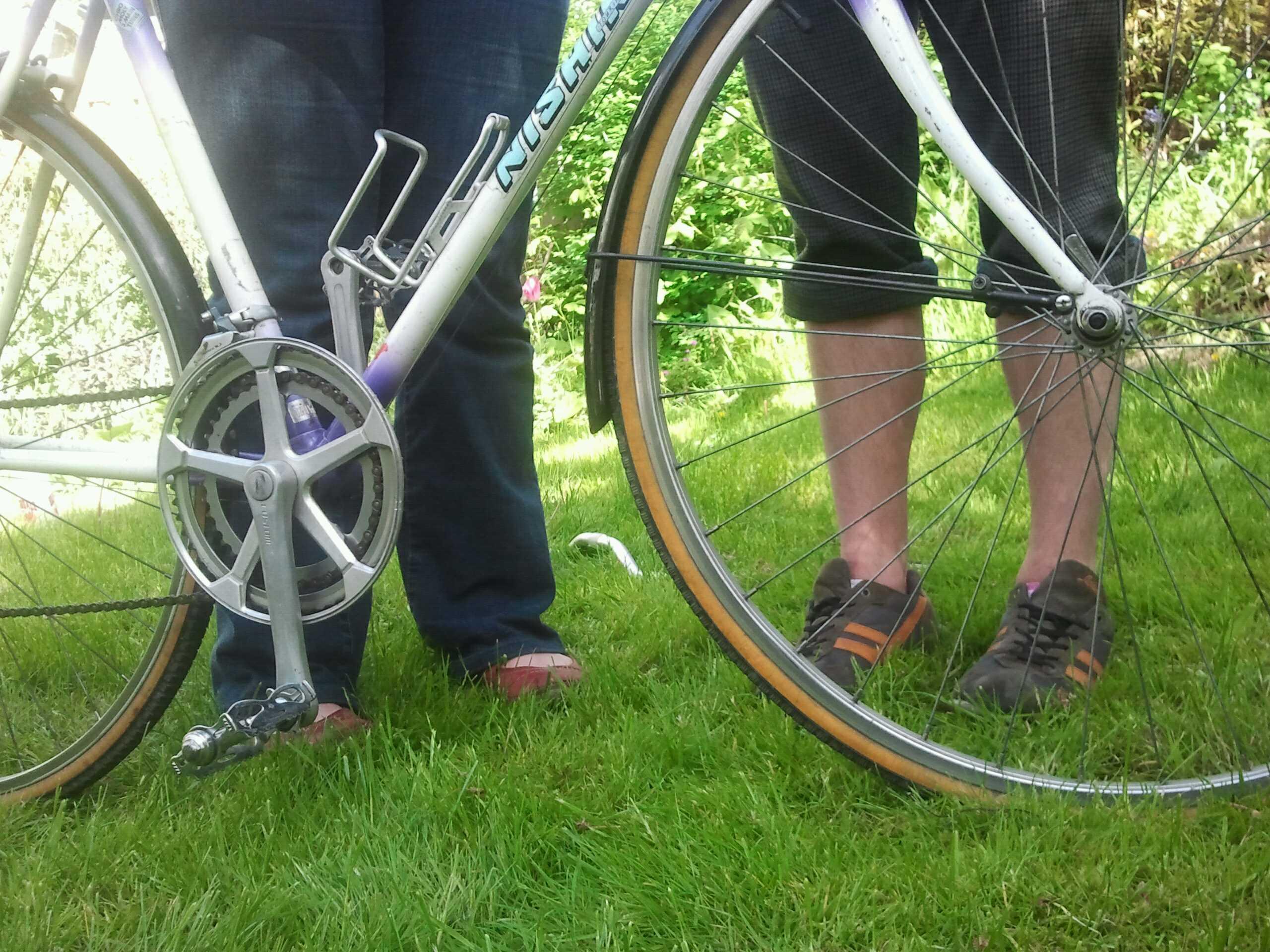 Bernard and Becky stand behind bike