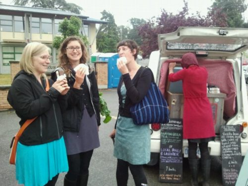 Becky Cory and Jess and Sarah Mundy have ice cream sandwiches at the Moss Street Market
