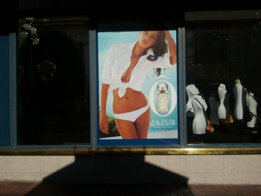Advertisement for perfume with a woman in a bikini