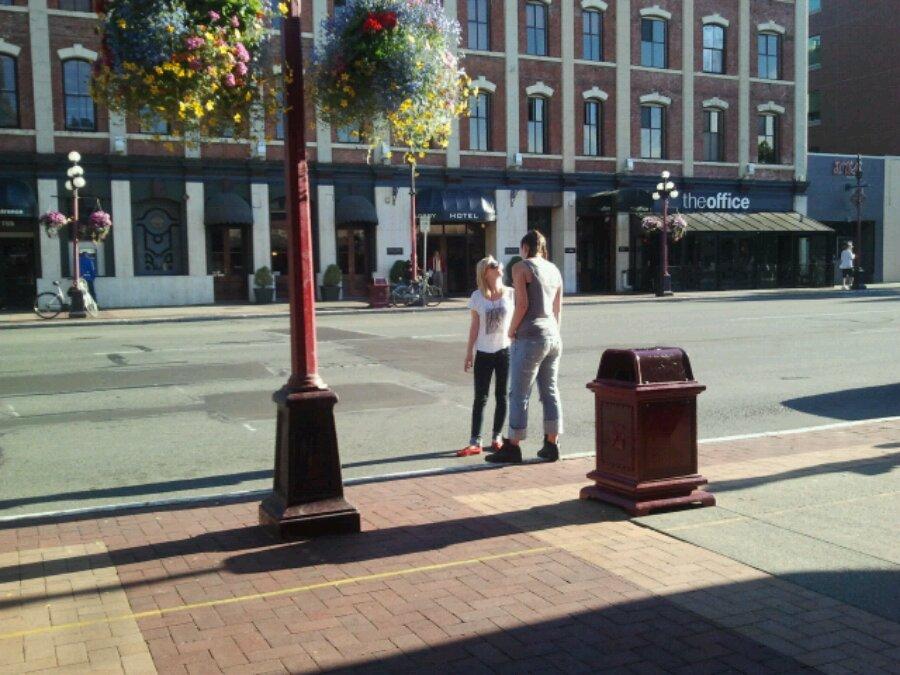Two young teenage smokers on the sidewalk