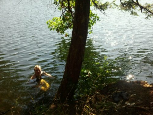 Becky Cory swims at Thetis lake in the summertime