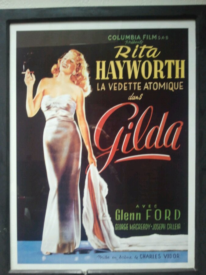 Poster with Rita Hayworth and multiple fonts