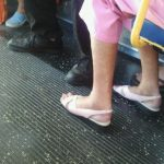 A woman's feet and toes on the public transit
