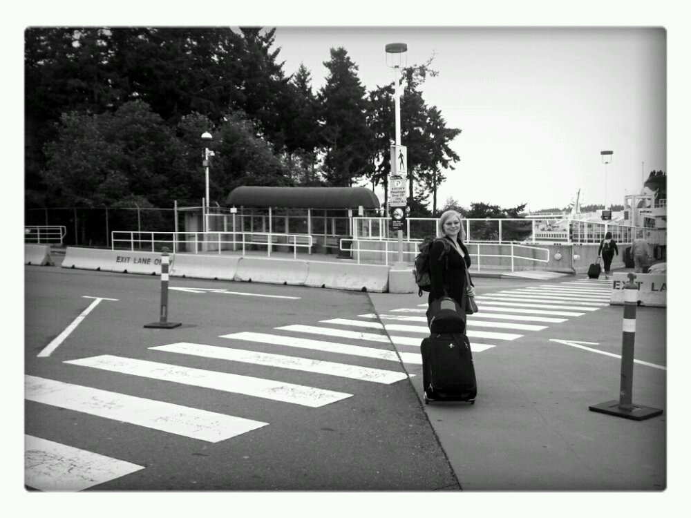 Rebecca Cory stands with her luggage about to embark on a Ferry to Vancouver