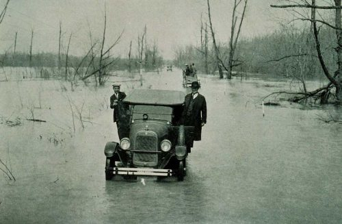 A car in a flood in 1927 in Mississippi