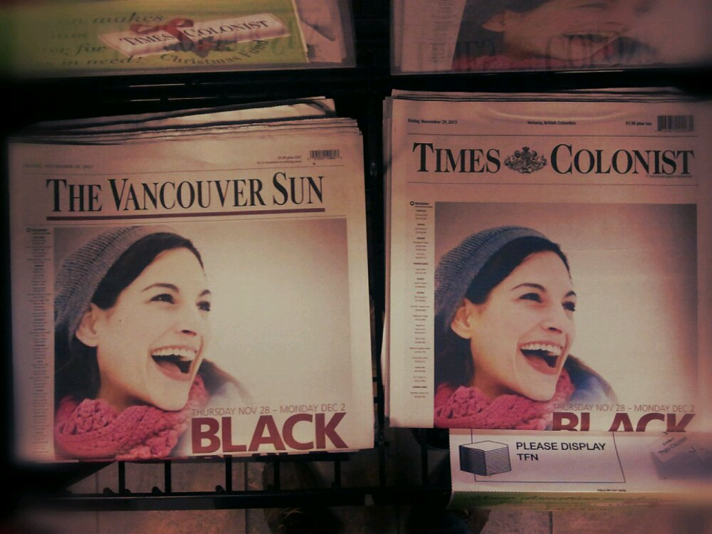 Vancouver Sun cover is identical full page ad to the Times Colonist