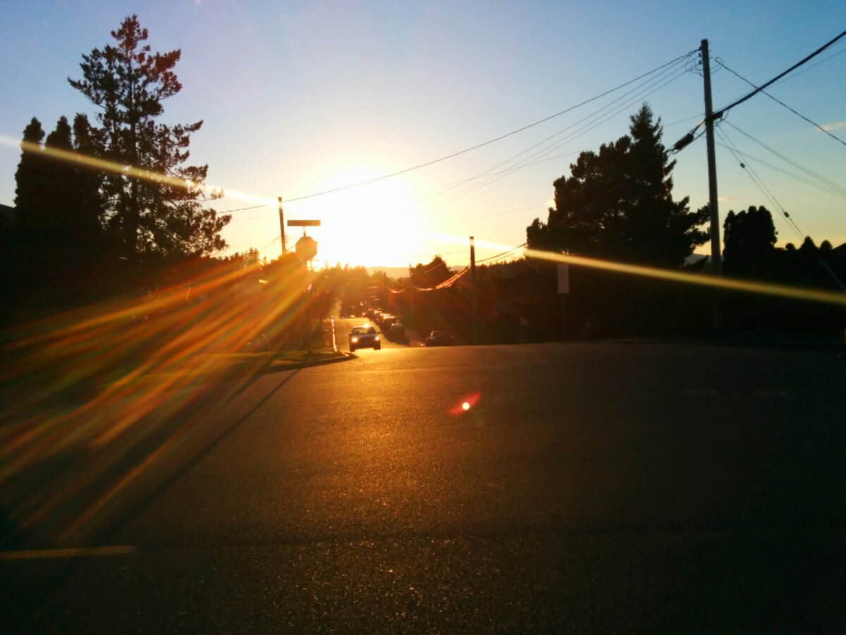 The sun shines brightly near sunset and reflects off of the VicWest pavement.