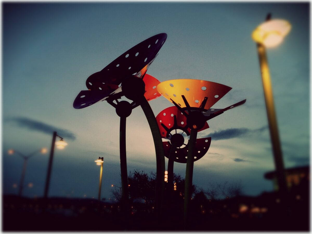 Giant metal art scuptures in the dusk light at the Victoria airport