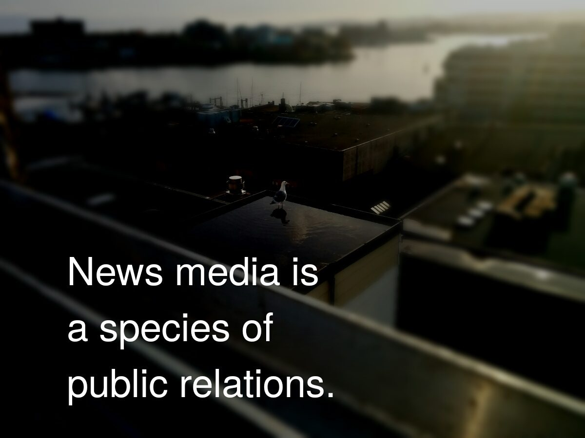 """Rooftop view of Victoria, with words, """"News media is a species of public relations."""""""
