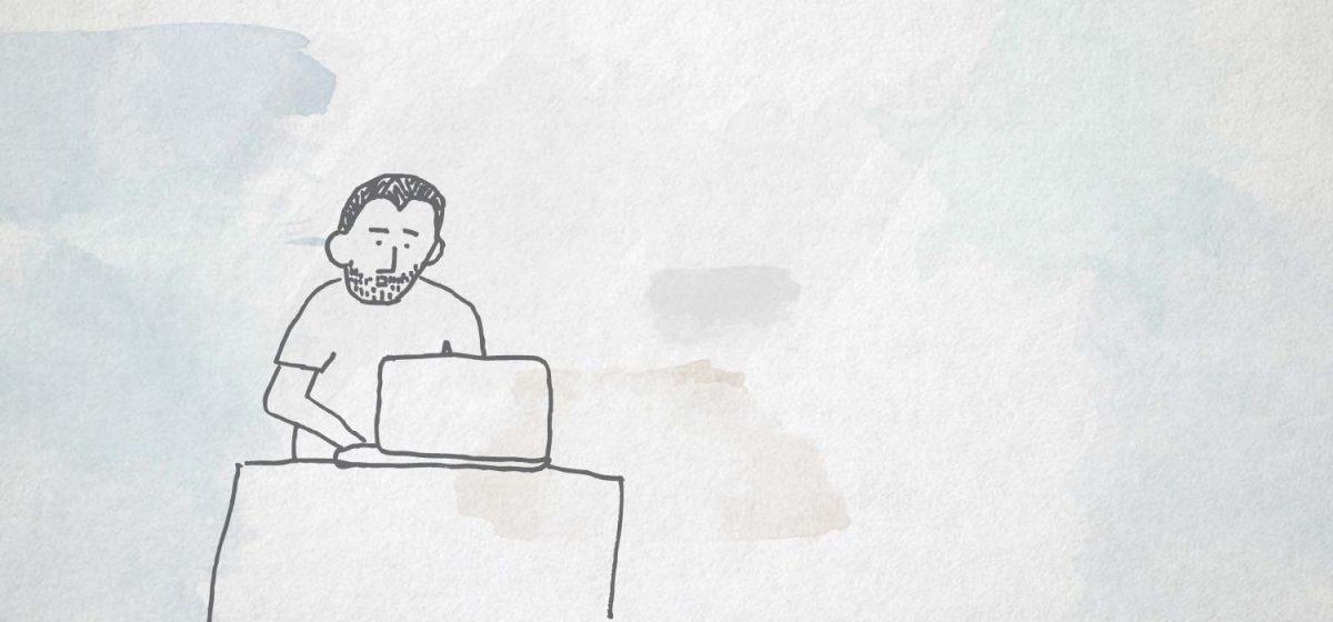 Sherwin writes at his desk