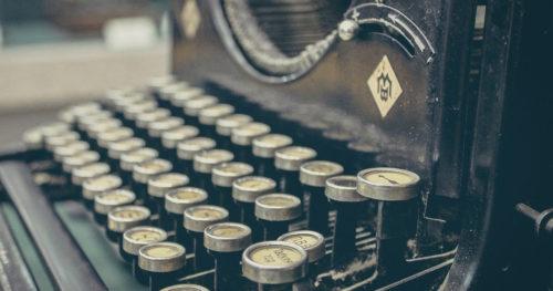 A close up of an old typewriter keyboard