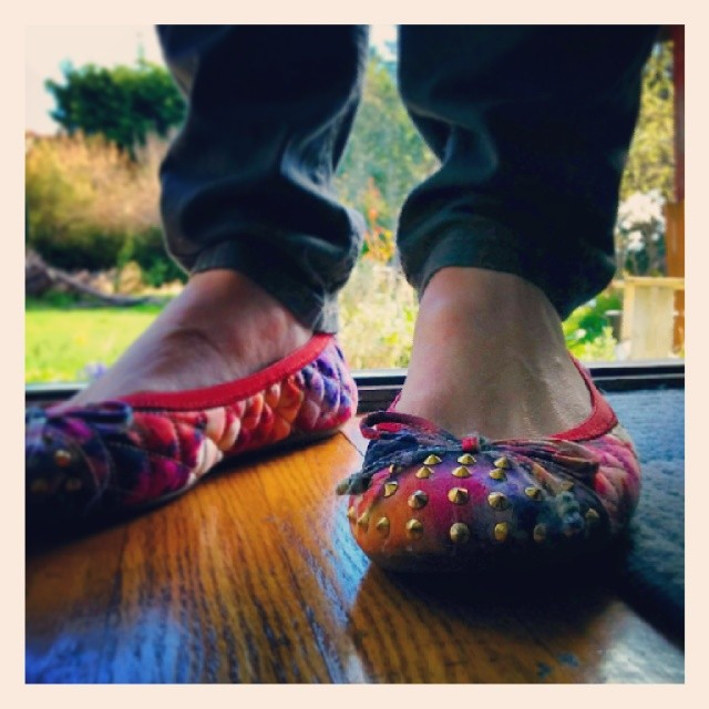Gilda poses with her colourful slippers on her deck in Oak Bay.