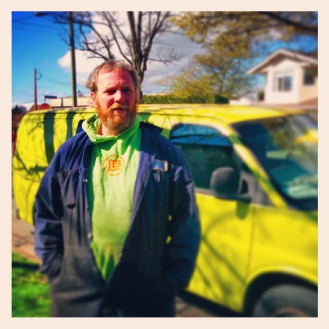 Brent poses in front of his lime green van.