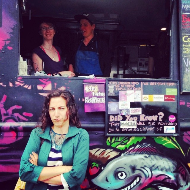 Sabrina poses looking grumpy in front of the Deadbeetz truck.