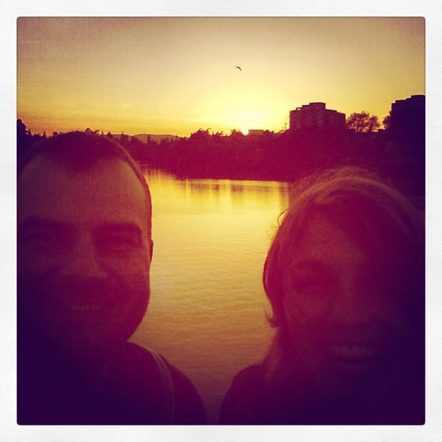 Kix and Sherwin smile at sunset on the harbour in Vicwest.